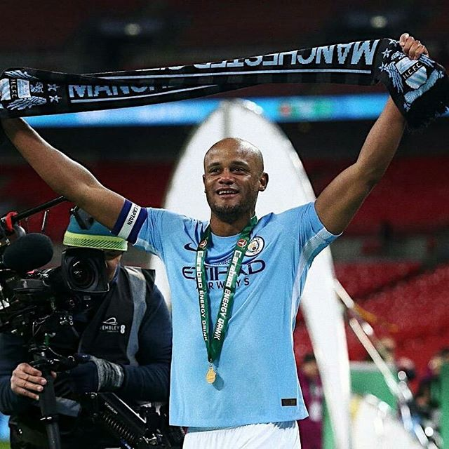 """Kompany to be immortalized at City. The """"mountain man"""", the captain, Vincent Kompany to be immortalized at @mancity .The 33-year-old Anderlecht player-coach has had his heroics at Manchester Blue honored in very special ways. Firstly, a road within the Cityzens' training ground has been renamed """"Vincent Kompany Crescent,"""" and the club has announced that a statue of Belgian will forever live at the Etihad Stadium. They have actually begun the process of commissioning the sculpture. In """"typical Kompany fashion,"""" according to the man himself, he had to miss out his testimonial due to a slight hamstring injury, a charity match between Manchester City legends and a Premier League All-Star cast that included Van Persie, Scholes and Van De Saar. The match finished 2-2 with former Zimbabwean international, Benjani Mwaruwari rescuing a draw for City."""