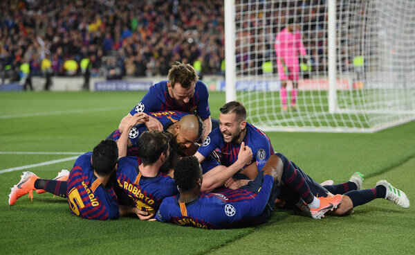 Lionel Messi of Barcelona celebrates with teammates after scoring his team's third goal during the UEFA Champions League Semi Final first leg match between Barcelona and Liverpool at the Nou Camp on May 01, 2019 in Barcelona, Spain.  (April 30, 2019 - Source: Getty Images Europe)