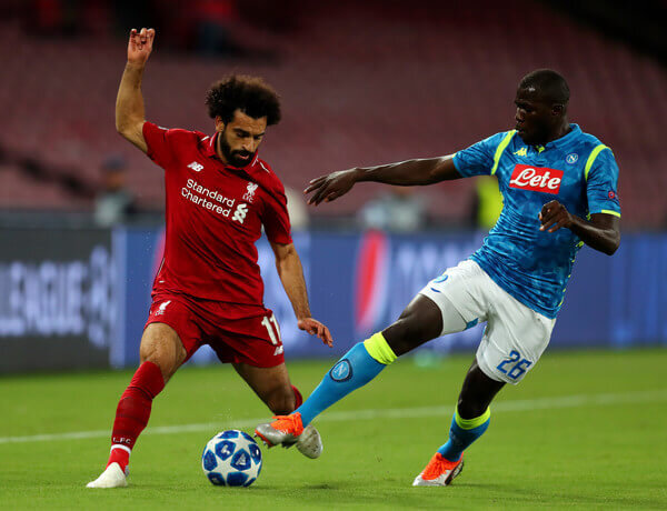 Mohamed Salah of Liverpool battles for possession with Kalidou Koulibaly of Napoli during the Group C match of the UEFA Champions League between SSC Napoli and Liverpool at Stadio San Paolo on October 3, 2018 in Naples, Italy.  (Oct. 2, 2018 - Source: Catherine Ivill/Getty Images Europe)