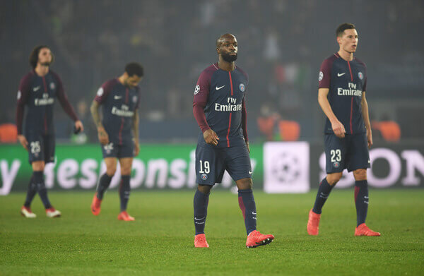 Lassana Diarra of PSG (19) and team mates look dejected in defeat after the UEFA Champions League Round of 16 Second Leg match between Paris Saint-Germain and Real Madrid at Parc des Princes on March 6, 2018 in Paris, France.  (March 5, 2018 - Source: Matthias Hangst/Getty Images Europe)