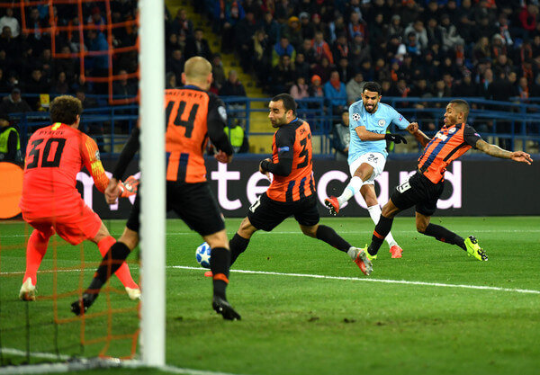 Riyad Mahrez of Manchester City shoots during the Group F match of the UEFA Champions League between FC Shakhtar Donetsk and Manchester City at Metalist Stadium on October 23, 2018 in Kharkov, Ukraine.  (Oct. 22, 2018 - Source: Mike Hewitt/Getty Images Europe)