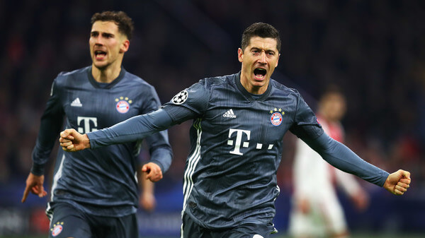Robert Lewandowski of Bayern Muenchen celebrates scoring his teams second goal of the game during the UEFA Champions League Group E match between Ajax and FC Bayern Munich at Johan Cruyff Arena on December 12, 2018 in Amsterdam, Netherlands.  (Dec. 11, 2018 - Source: Dean Mouhtaropoulos/Getty Images Europe)
