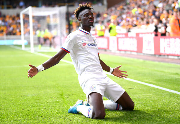 Tammy Abraham of Chelsea celebrates after scoring his team's fourth goal during the Premier League match between Wolverhampton Wanderers and Chelsea FC at Molineux on September 14, 2019 in Wolverhampton, United Kingdom.  (Sept. 13, 2019 - Source: Getty Images Europe)