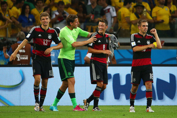 (L-R) Thomas Mueller, Manuel Neuer, Mesut Oezil and Philipp Lahm of Germany celebrate a 7-1 victory over Brazil during the 2014 FIFA World Cup Brazil Semi Final match between Brazil and Germany at Estadio Mineirao on July 8, 2014 in Belo Horizonte, Brazil.  (July 7, 2014 - Source: Robert Cianflone/Getty Images South America)