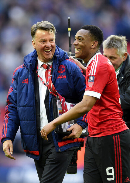 Louis van Gaal manager of Manchester United celebrates with winning goalscorer Anthony Martial of Manchester United after victory in The Emirates FA Cup semi final match between Everton and Manchester United at Wembley Stadium on April 23, 2016 in London, England.  (April 22, 2016 - Source: Mike Hewitt/Getty Images Europe)