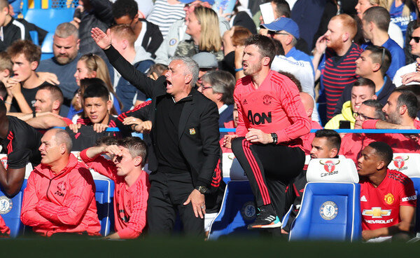 Jose Mourinho manager of Manchester United appeals as assistant coach Michael Carrick looks on during the Premier League match between Chelsea FC and Manchester United at Stamford Bridge on October 20, 2018 in London, United Kingdom.  (Oct. 19, 2018 - Source: Catherine Ivill/Getty Images Europe)