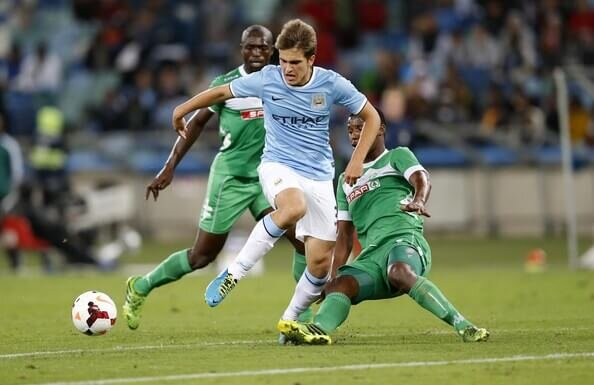 Denis Suarez of Manchester City beats the Amazulu defense during the Nelson Mandela Football Invitational match between AmaZulu and Manchester City at Moses Mabhida Stadium on July 18, 2013 in Durban, South Africa.  (July 17, 2013 - Source: Gallo Images/Getty Images Europe)