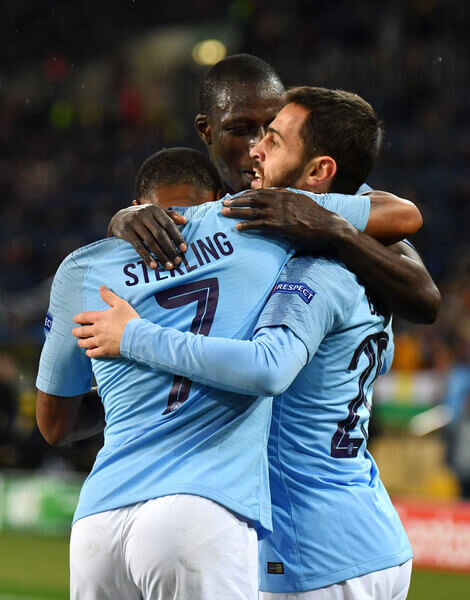 Bernardo Silva of Manchester City celebrates with teammates after scoring his team's third goal during the Group F match of the UEFA Champions League between FC Shakhtar Donetsk and Manchester City at Metalist Stadium on October 23, 2018 in Kharkov, Ukraine.  (Oct. 22, 2018 - Source: Mike Hewitt/Getty Images Europe)