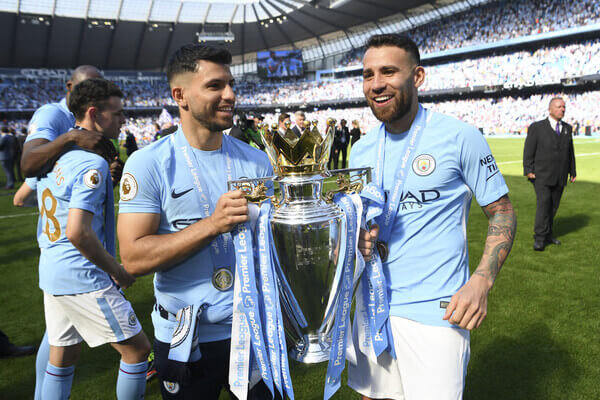 Sergio Aguero and Nicolas Otamendi with the Premier league trophy after the Premier League match between Manchester City and Huddersfield Town at Etihad Stadium on May 6, 2018 in Manchester, England.  (May 5, 2018 - Source: Michael Regan/Getty Images Europe)