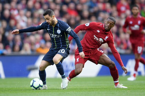 Bernardo Silva of Manchester City controls the ball under pressure from Georginio Wijnaldum of Liverpool during the Premier League match between Liverpool FC and Manchester City at Anfield on October 7, 2018 in Liverpool, United Kingdom.  (Oct. 6, 2018 - Source: Laurence Griffiths/Getty Images Europe)