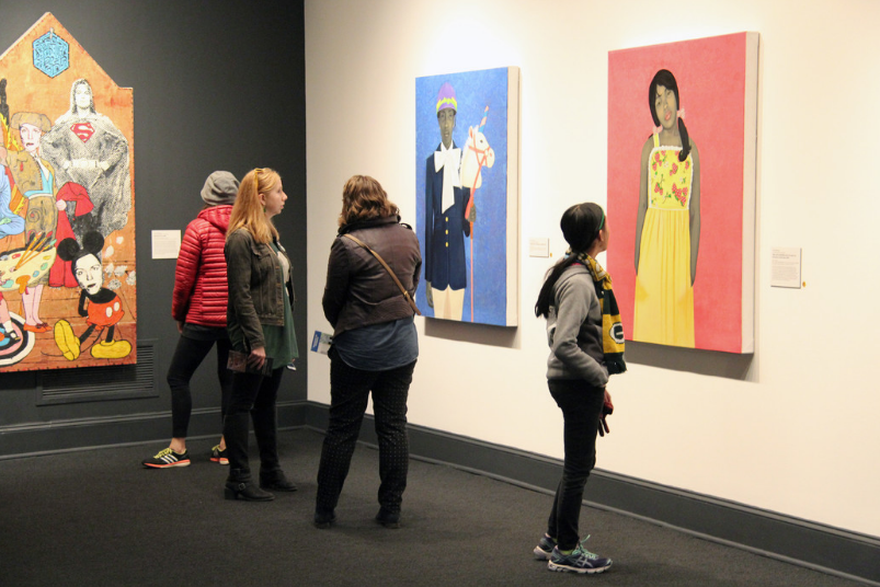 NMWA visitors study Amy Sherald's  It Made Sense…Mostly In Her Mind , 2011 (left) and  They call me Redbone but I'd rather be Strawberry Shortcake , 2009 (right); Photo: Emily Haight, NMWA