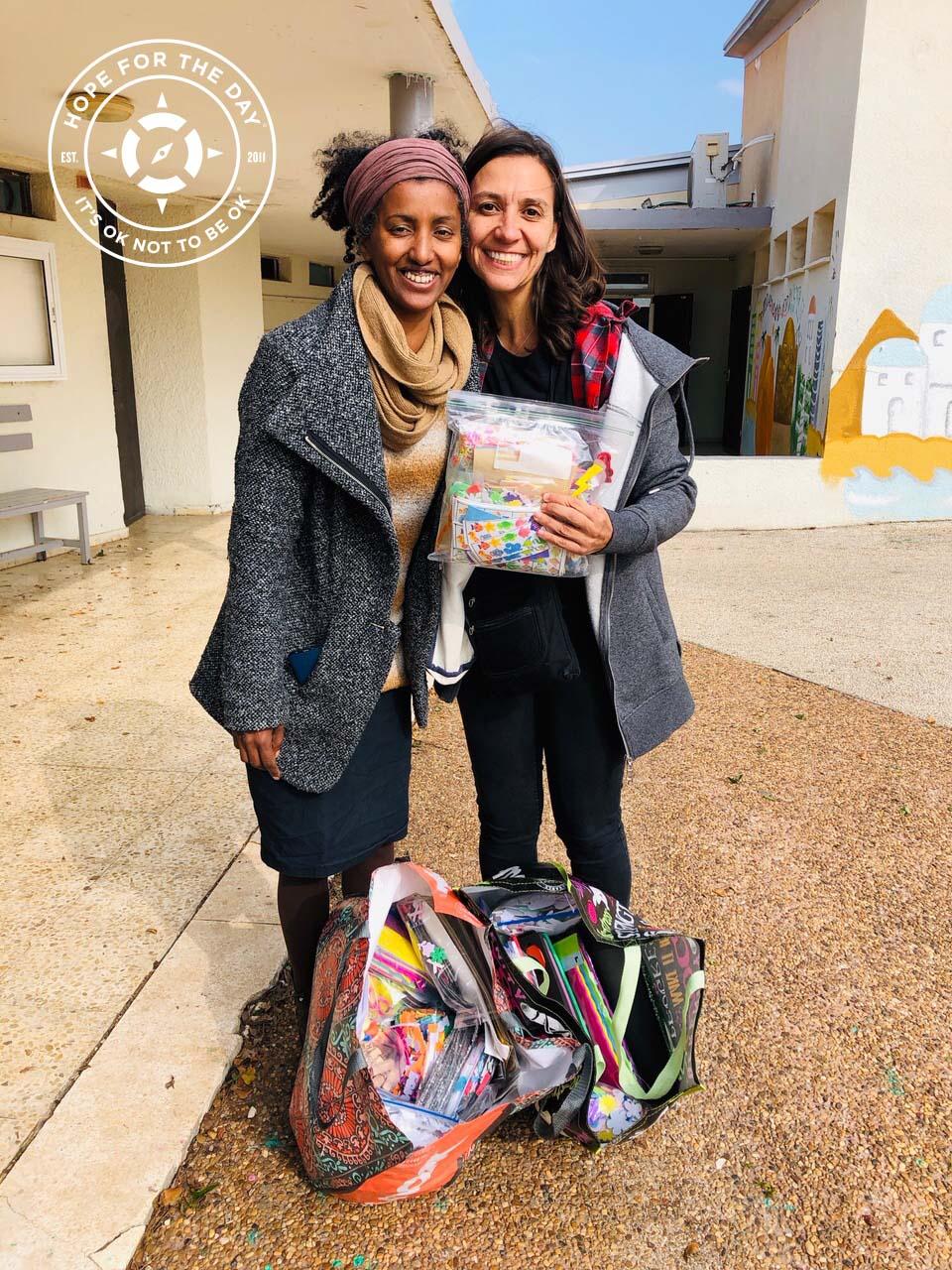 Nancy and Racheli with donated supplies in Yemin Orde. Photo: Nancy Bartosz