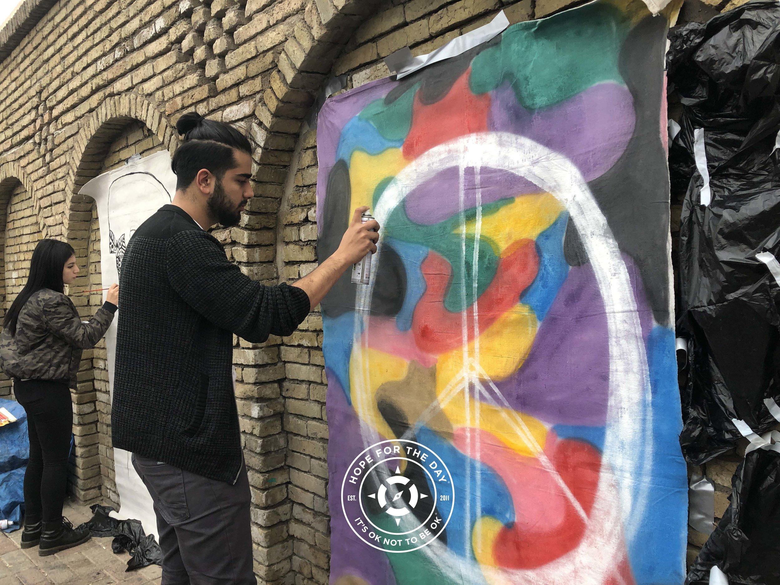 The two kurdish artists at work on the Erbil Citadel Hope Mural. Photo: Nancy Bartosz