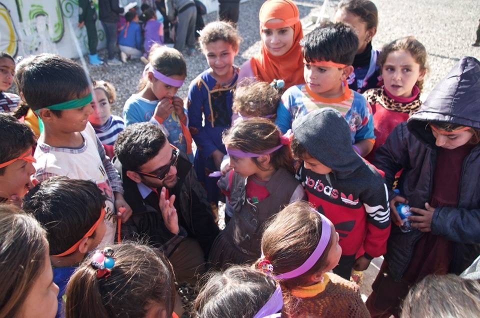 "Mohammed ""Mo"" Hawar engaging and educating Kurdish children. Photo: Jason Everett"