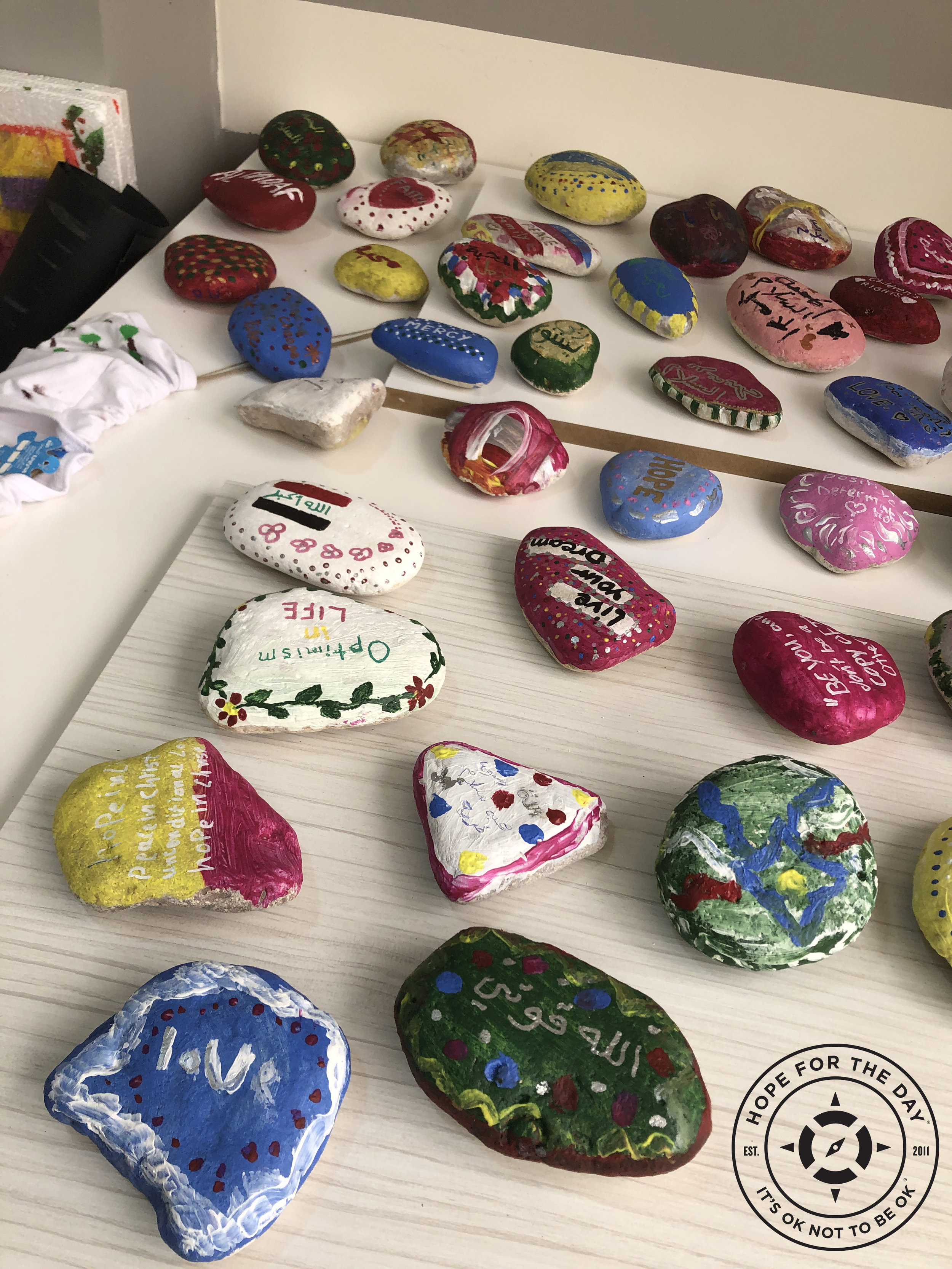 Freshly painted rocks, decorated with positivity for the Kindness Rocks Project Photo: Nancy Bartosz