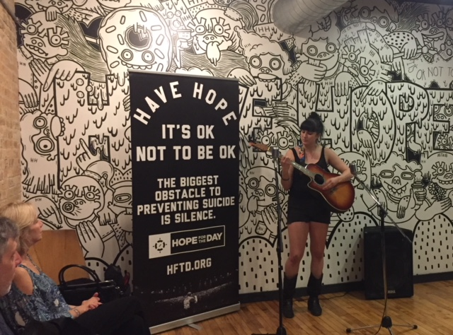 "Singer/songwriter and survivor, Alex Subak performing her song ""Fight""."