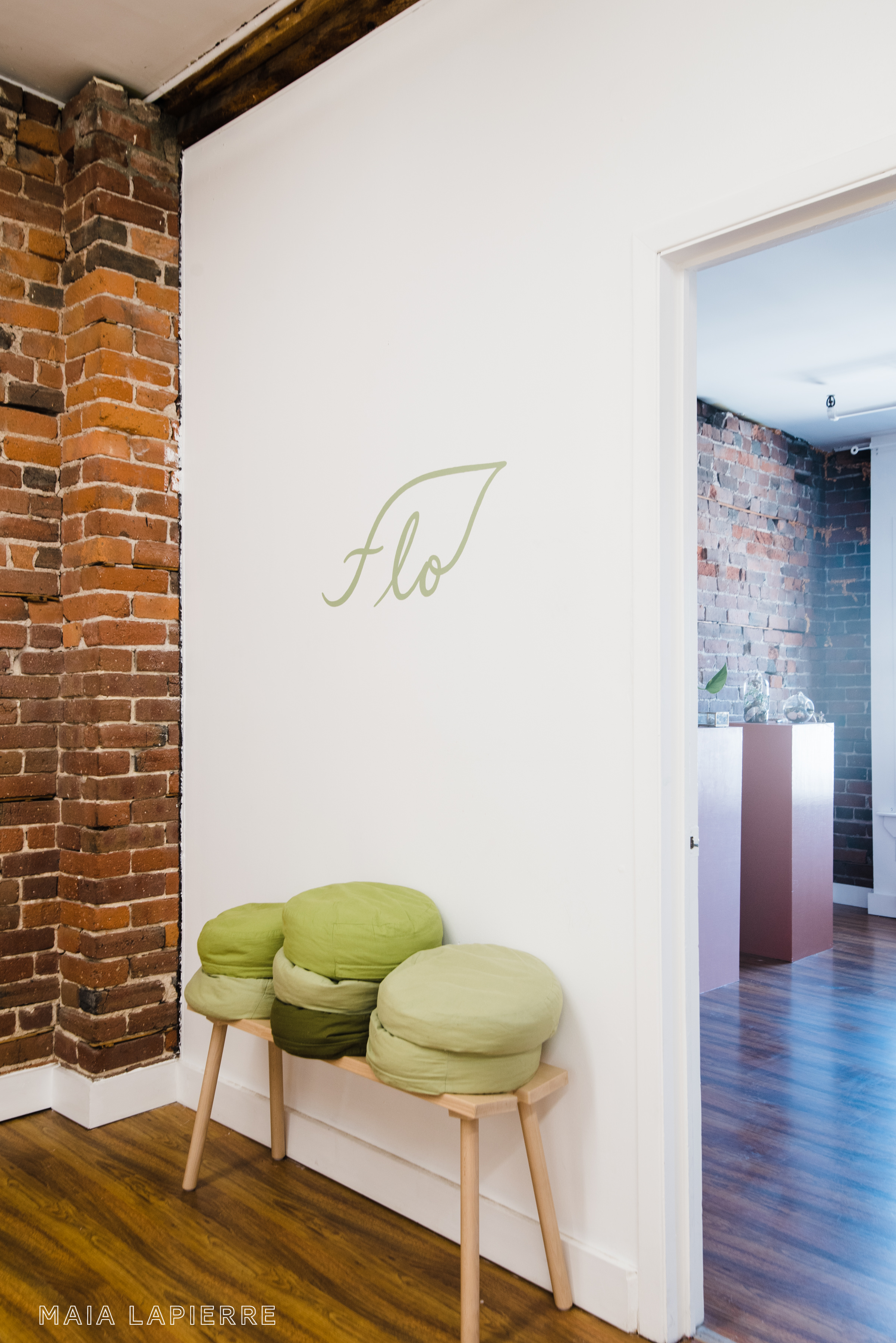 View from studio into boutique. Logo designed and hand-painted by  Lizane Tan . Photo by  Rachael Shrum