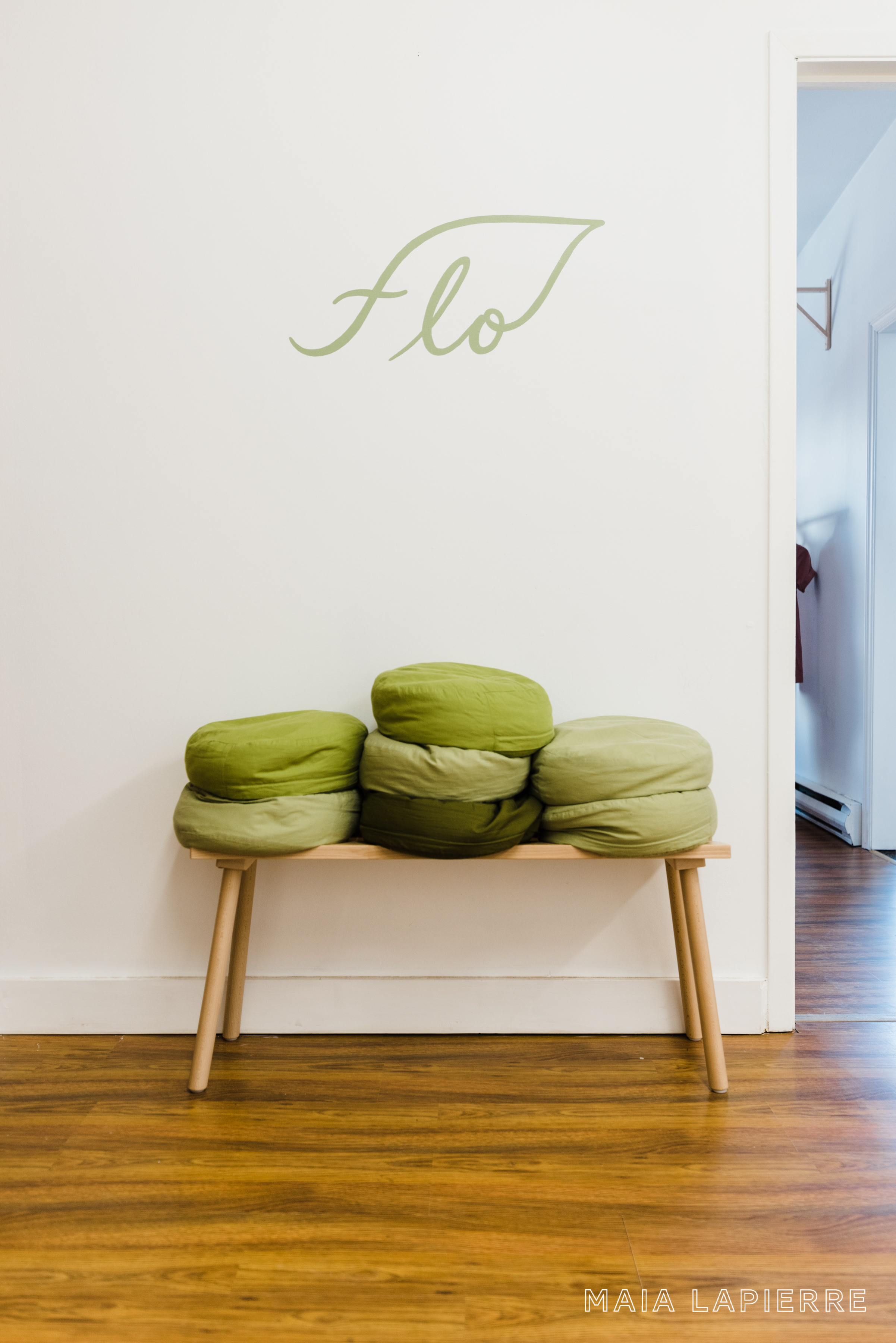 Logo hand-painted by  Lizane Tan  with meditation pillows sewn by Pamela Stone. Photo by  Rachael Shrum