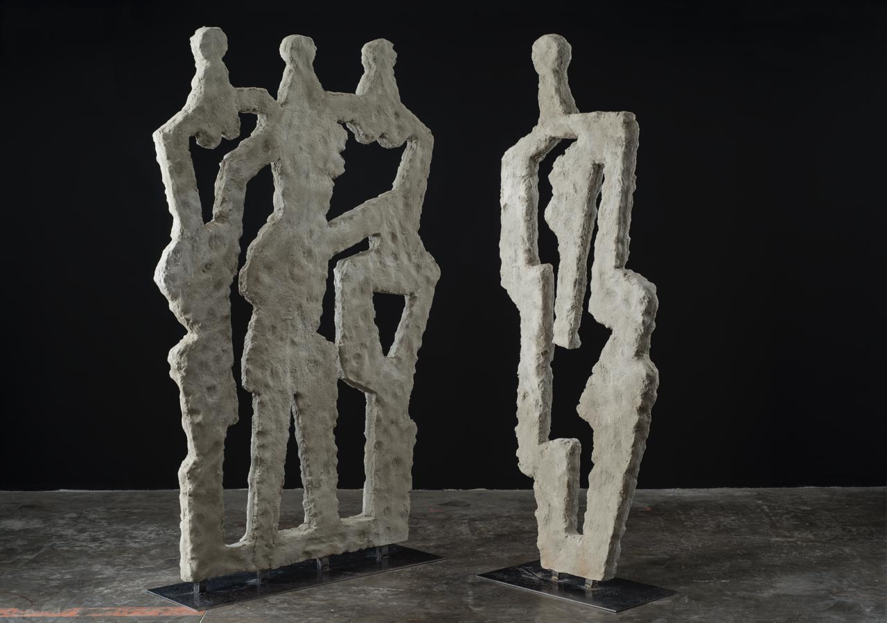 "The Three Graces   Left Sculpture: Metal, foam and cement on metal base  89"" x 56"" x 3"" Inches   The Woman   Right Sculpture: Metal, foam and cement on metal base  89"" x 31"" x 3"" Inches"