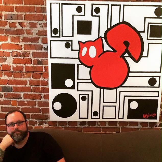 William Lyday in front of one of his originals titled  Big Red