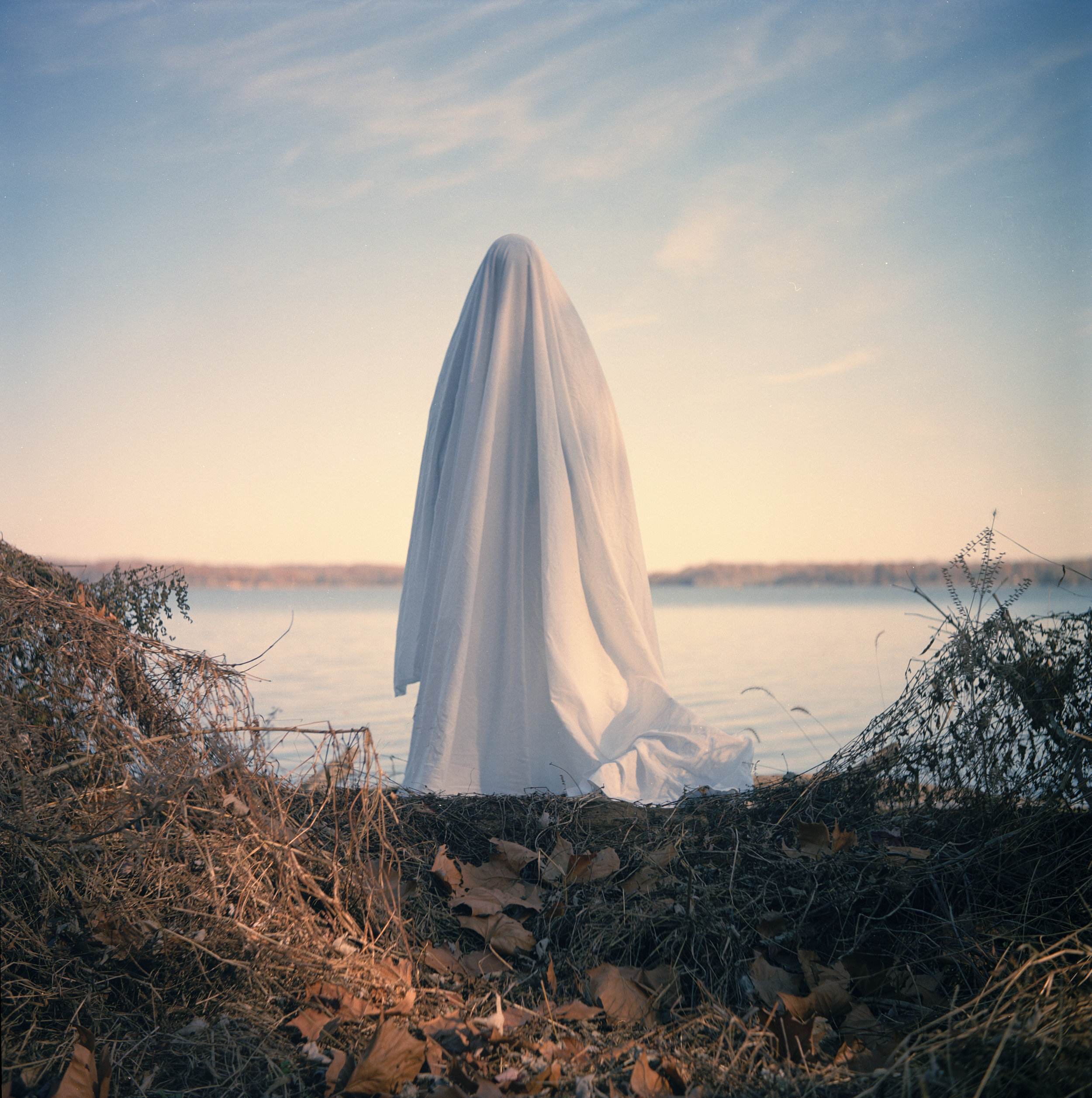 Ghost ,  2017    This series is a mix of medium format film & digital. It questions time and the duality it has with living. After my grandmother passed away, I wanted to explore the concept of death and how the soul can transcend through dimensions despite the physicality of the person being absent.