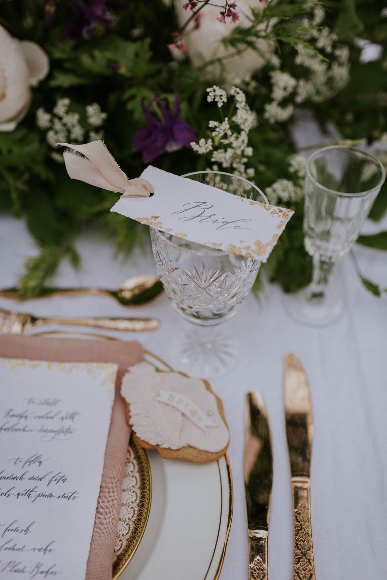 Romantic calligraphy details for a secret garden wedding in the English countryside.