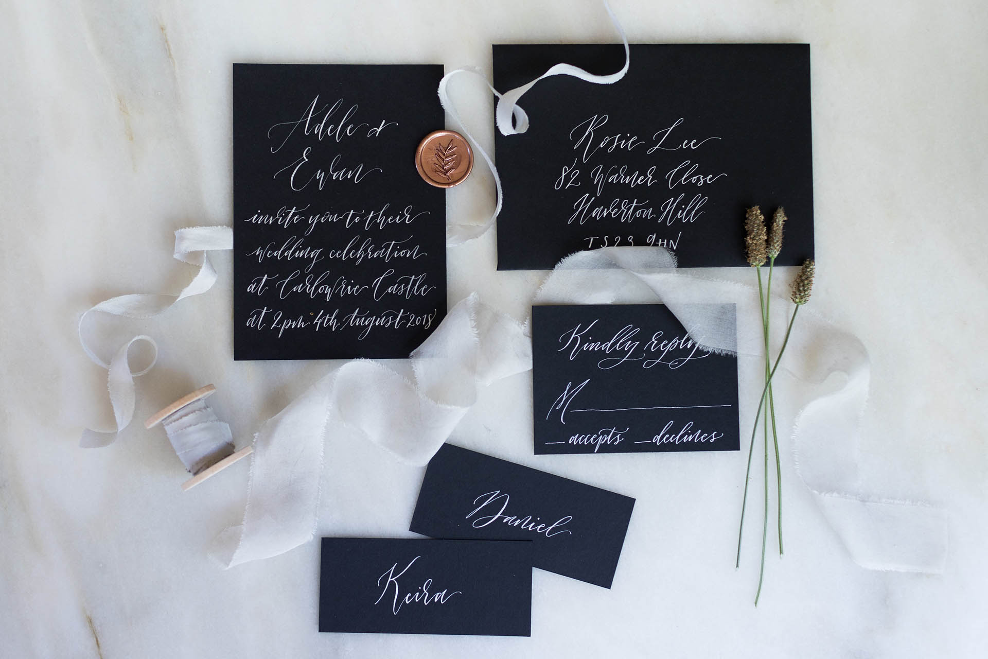 Dramatic silver ink on black paper stock for a modern city wedding.