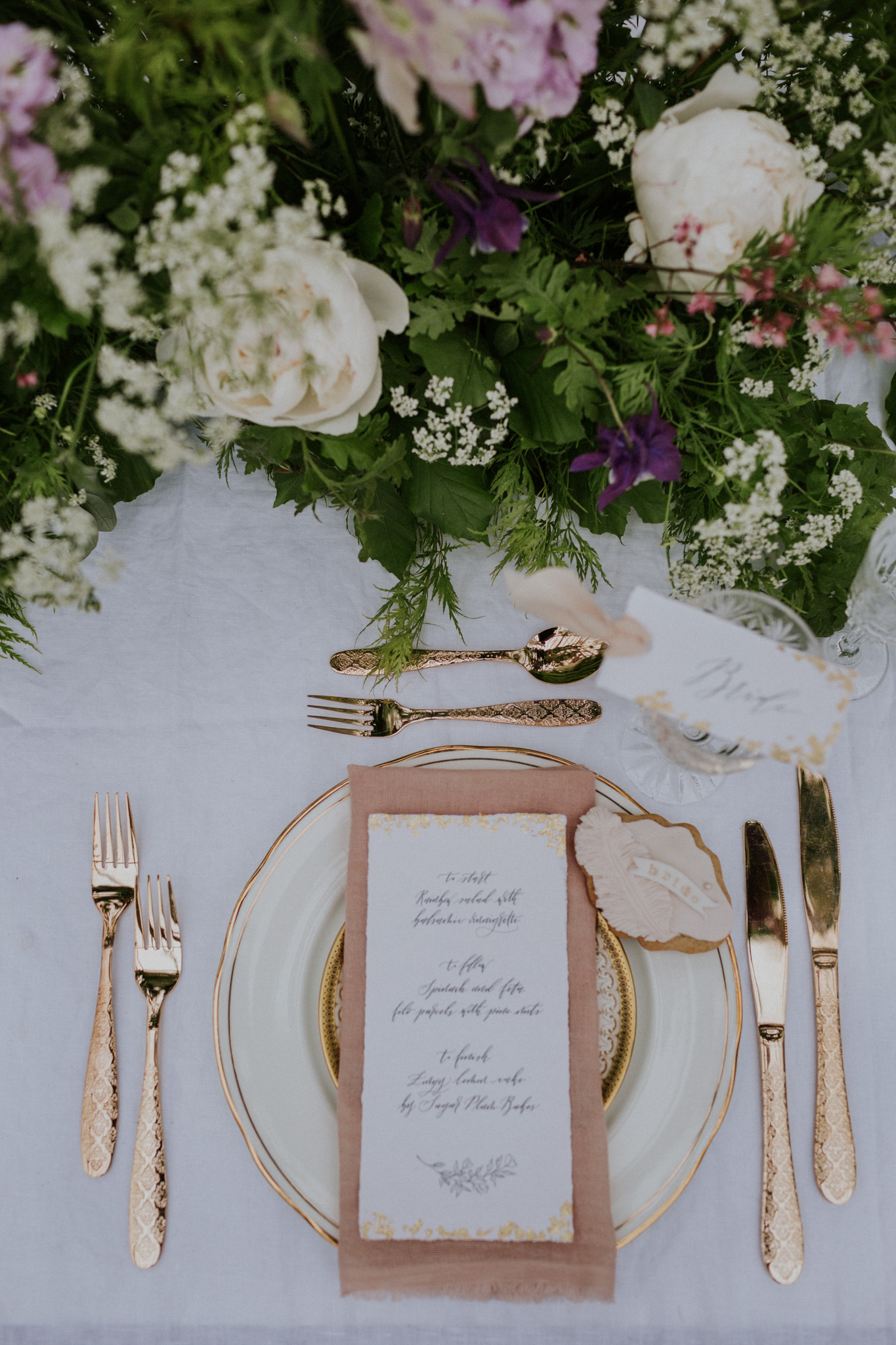 Romantic wedding menu and place card on handmade paper with deckled edges.