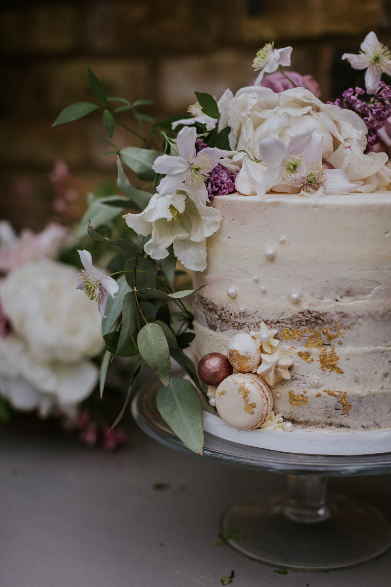 Utterly stunning romantic wedding cake details including speckles of gold leaf and edible pearls.