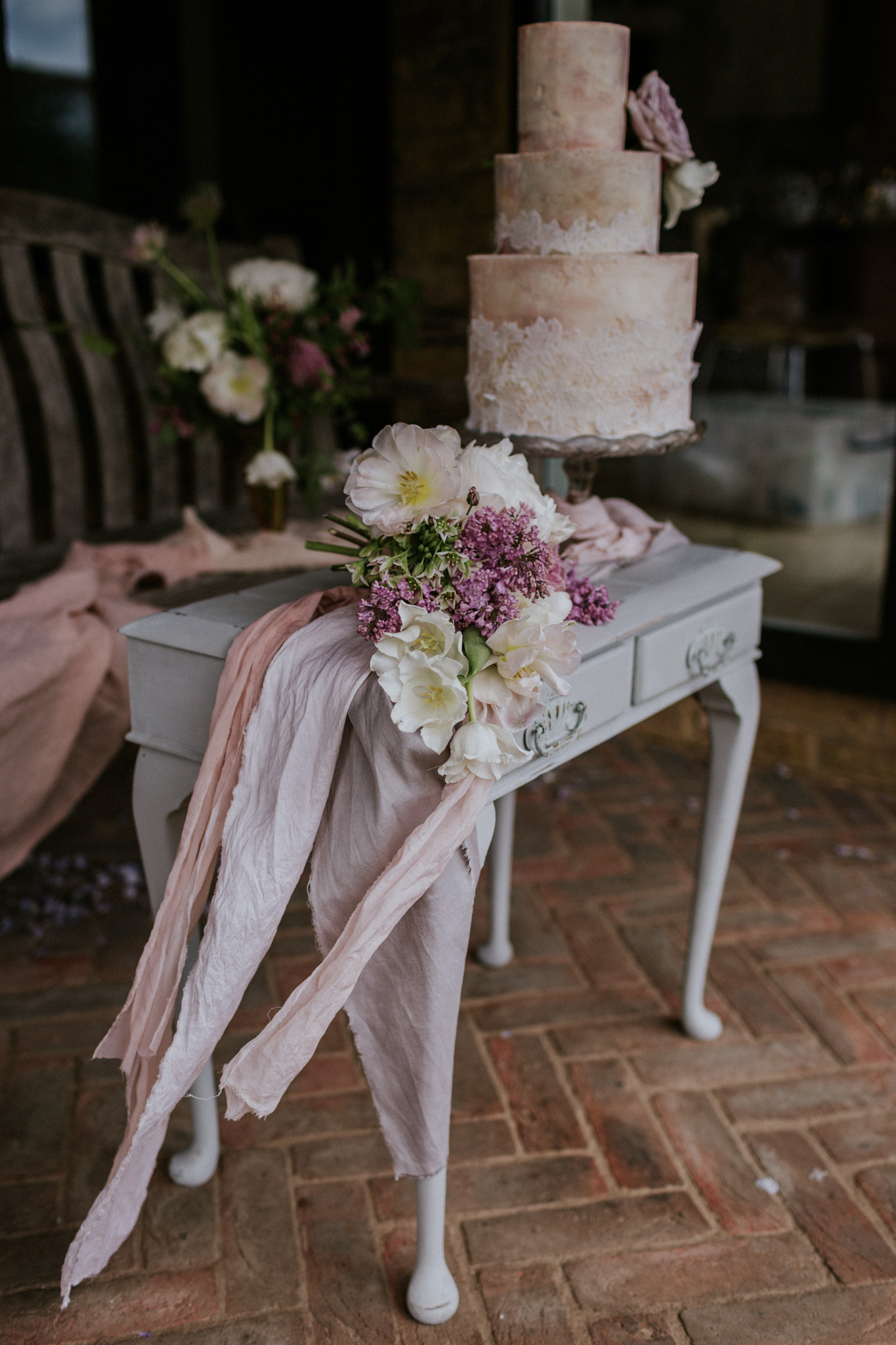 Gorgeous florals and the second beautifully artistic wedding cake design.