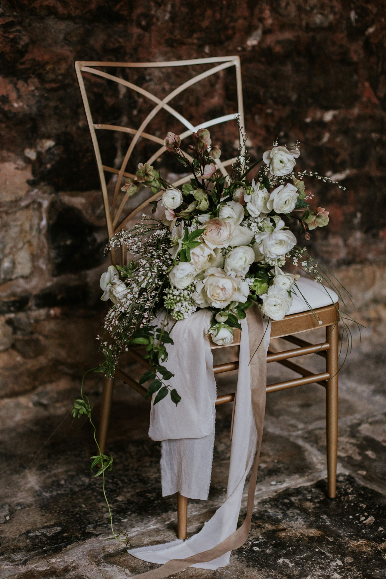 Leigh filled the beautiful bouquet with white blooms and leafy foliage for a beautiful sense of movement.