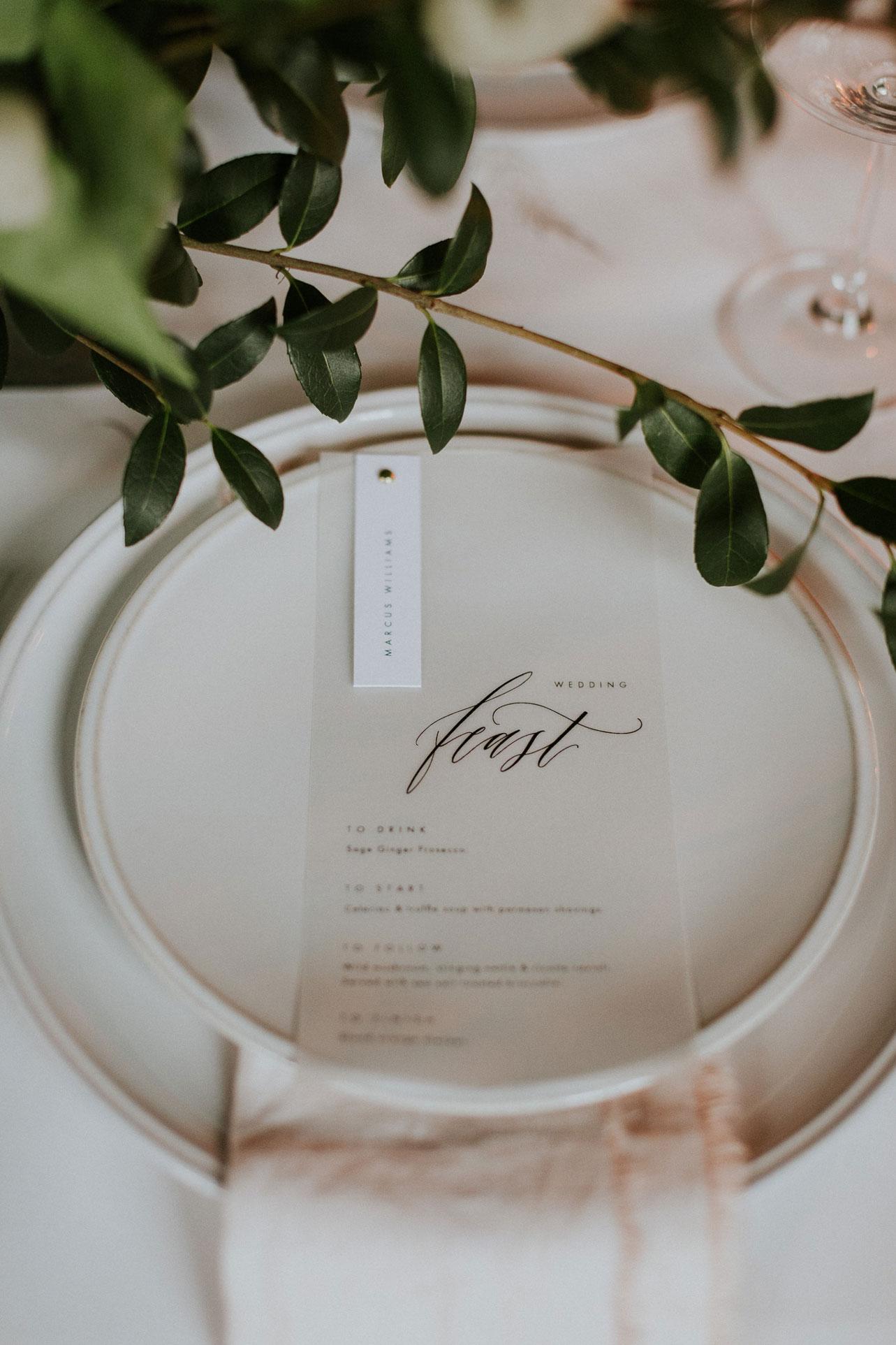 The semi sheer vellum adds a crisp modern feeling to the wedding menus.
