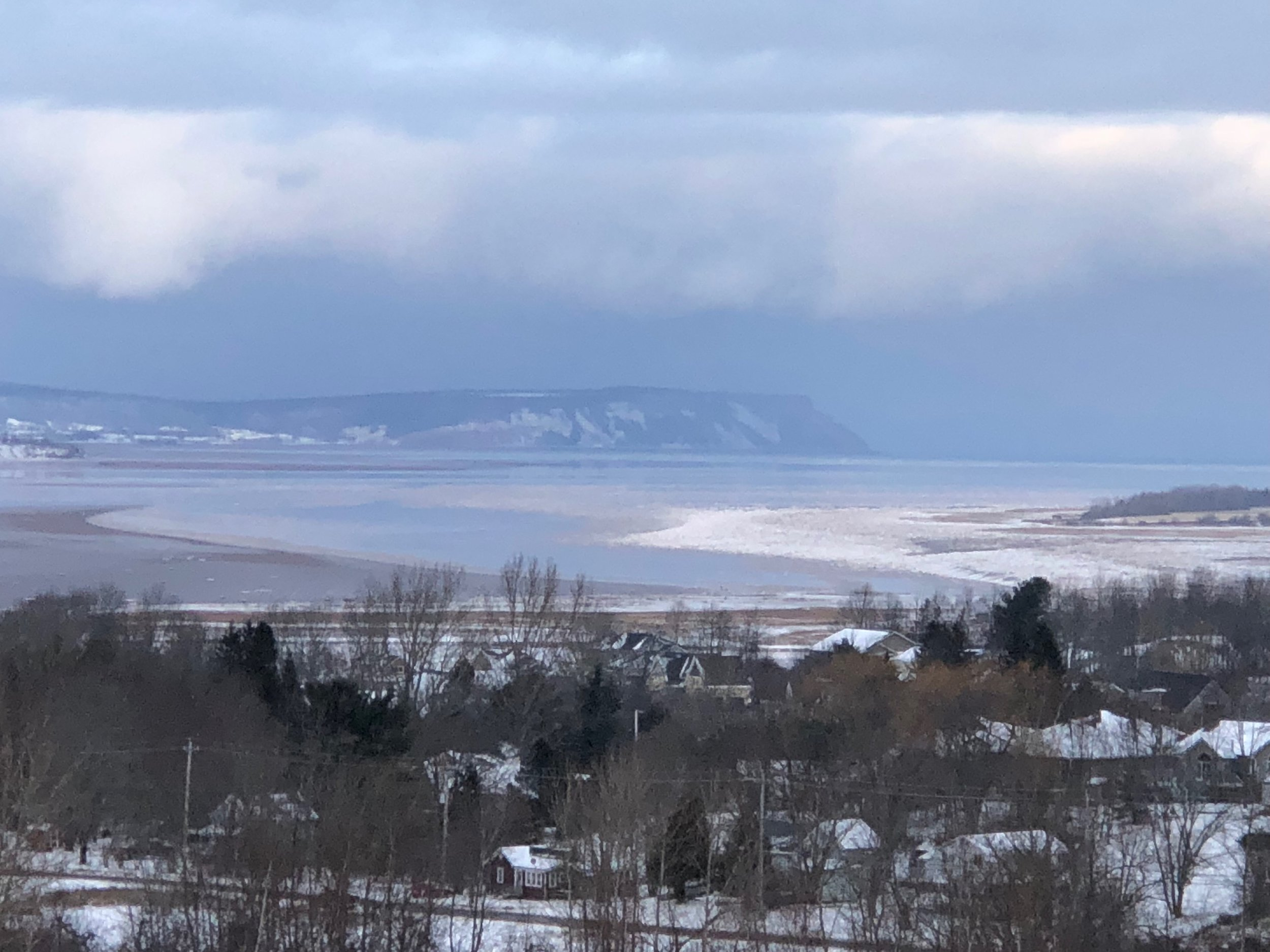 Cape Blomidon rises over the Minas Basin and the Bay of Fundy