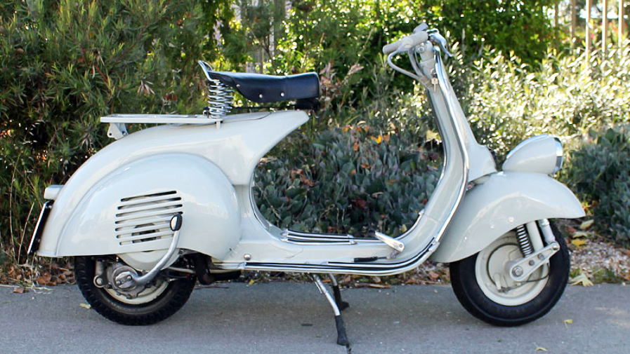 1953 VESPA FARO BASSO (IC-220) - The wide handlebars and low seat-height combine to create a riding experience like no other vehicle. The Faro Basso Vespa is a classic design for all time.