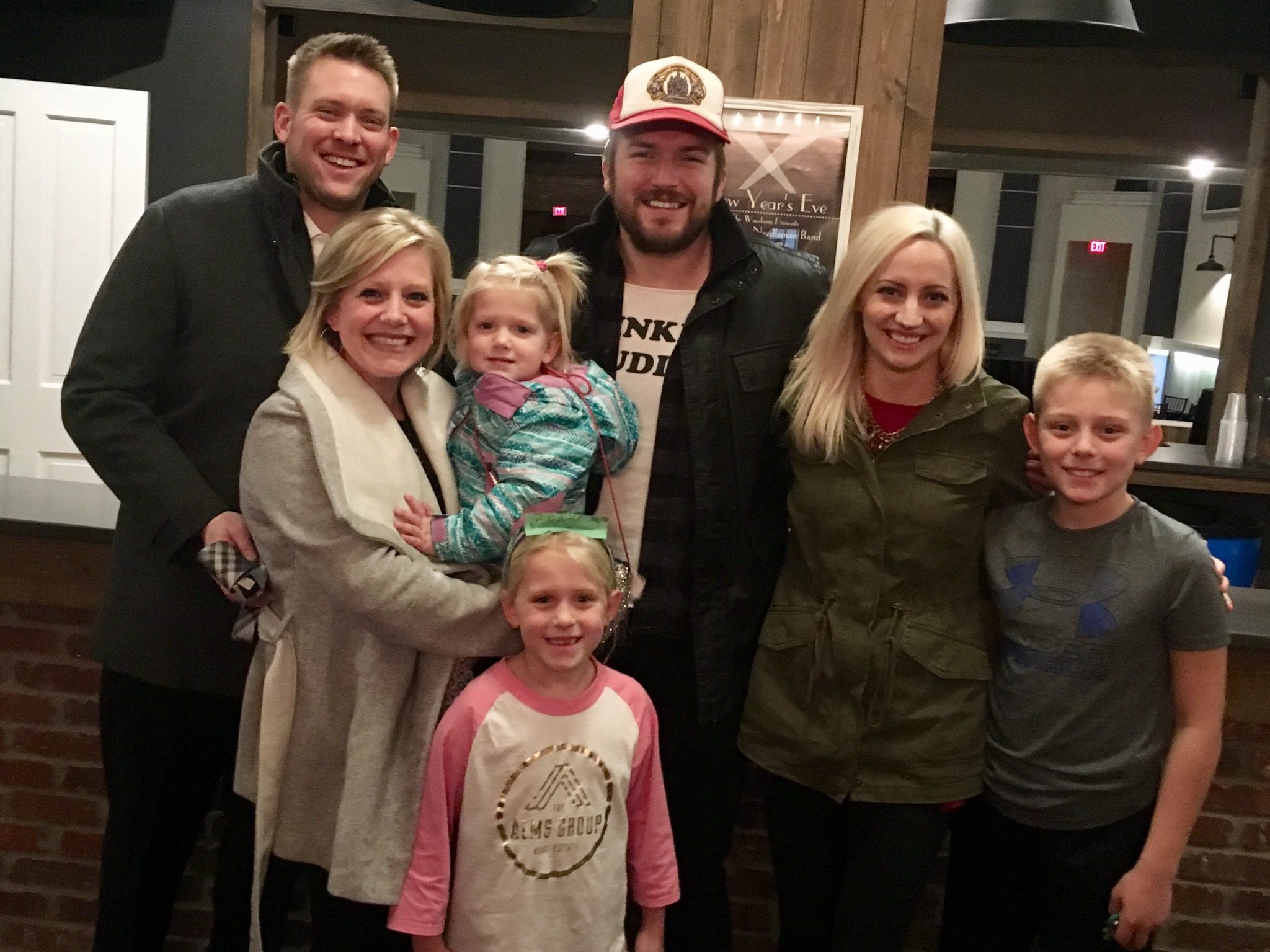 The Alms Group's Mike Goodpasture and his family, with Logan and his wife, Jill.