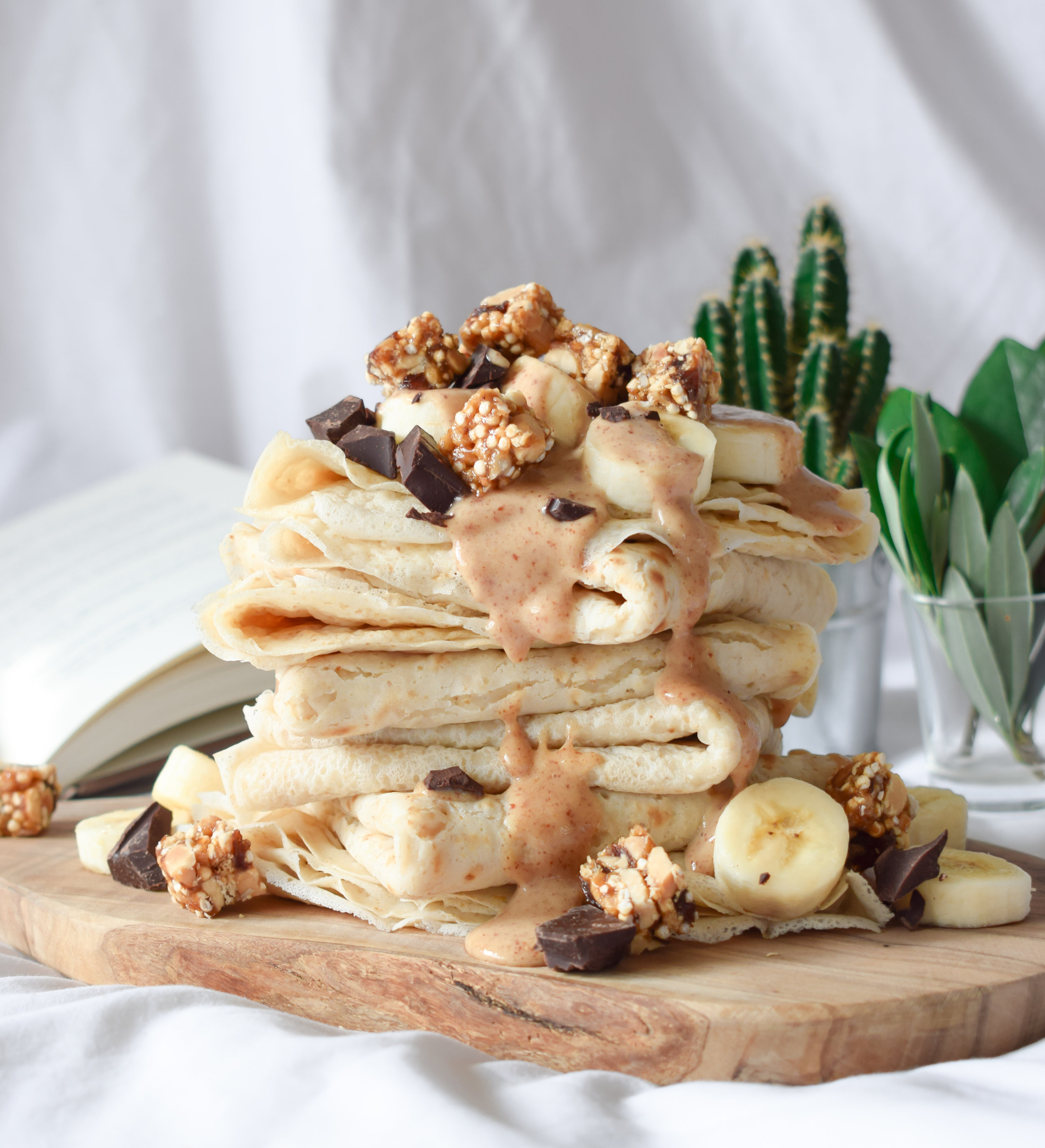 Vegan crêpe stack topped with chunks of Perk!er's Peanut Quinoa Bar
