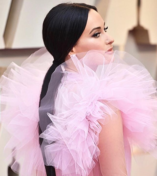 """Happy #oscars to specifically @spaceykacey and her stunning pink frills from @giambattistavalliparis which kind of remind us of the textures found in the work of @msliztolson's """"my body is not your body"""" (up on our website now) 🥰🌷💓 Photo from @giovanni__delgado"""