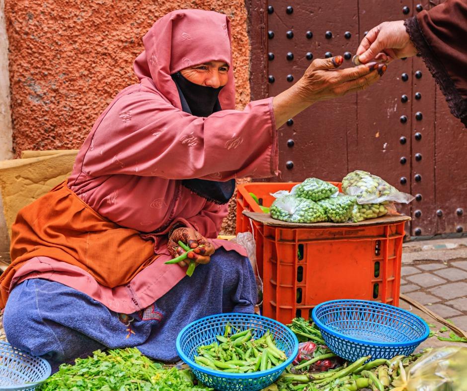 MARRAKECHmorrocan-woman-selling-vegetables-on-street-market-FACEBOOK.jpg
