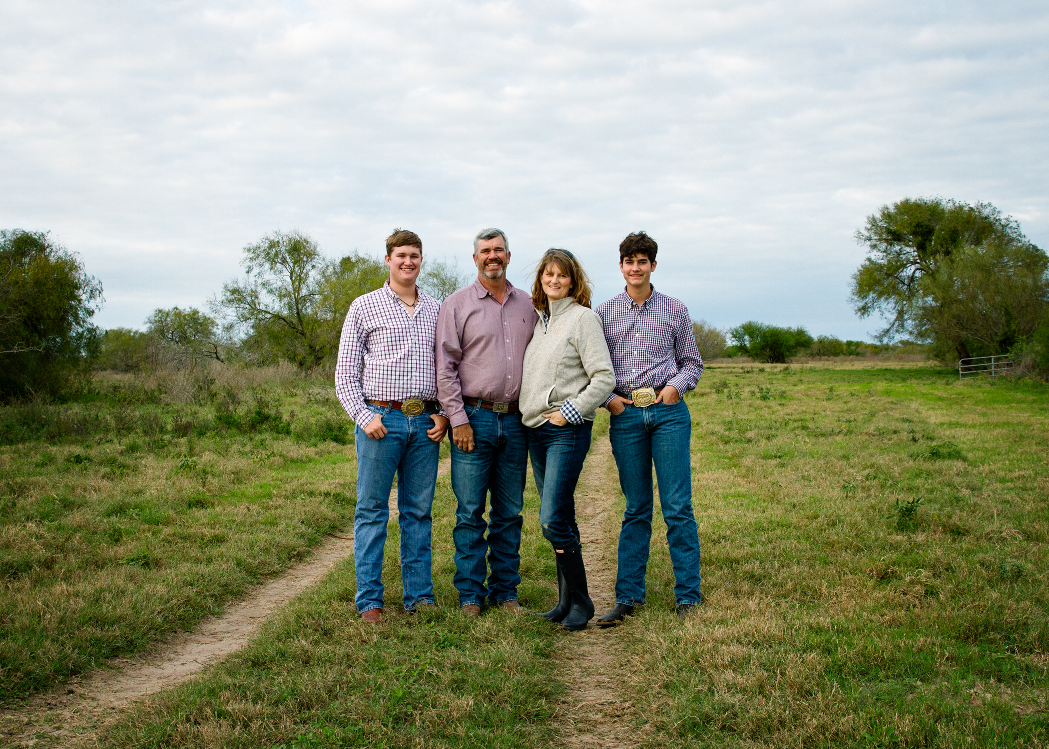 We are Jon, Kelly, Payne, & Jackson Whatley.  - Jon is the 4th generation in his family to farm. Kelly is not a country girl, but has adapted to farming and South Texas life over the past 25 years. Payne attends Texas A&M, and Jack is a senior in high school. Despite retiring several years ago, Jon's dad, Bob, still comes to work each day and can be found on the farm or out with the cattle.