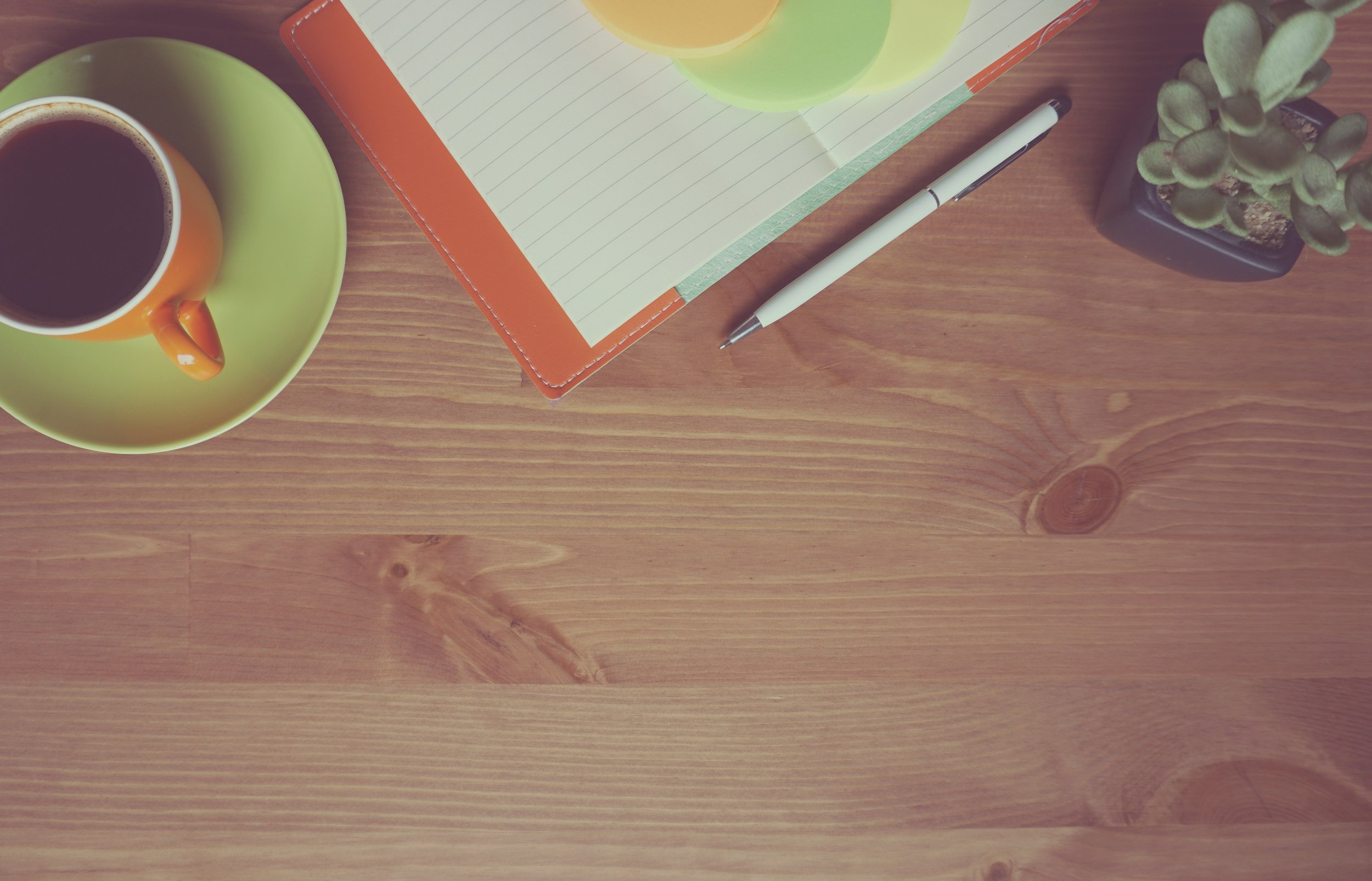 coffee-green-cup-notebook-wood-table-pen-plant-freephotoscc.jpg