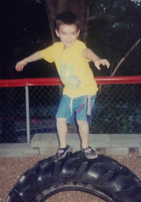 benny riding the tire.jpg