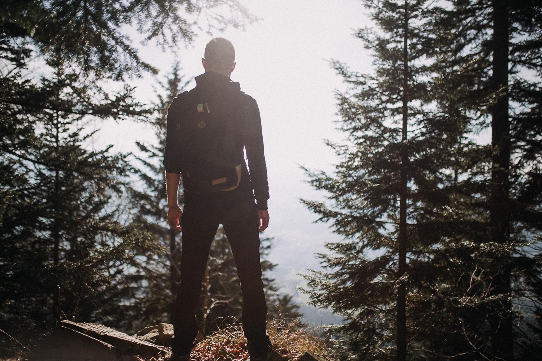 Bucket-list-boy-in-forest-mountains