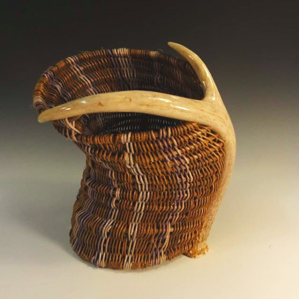 FRONTIER BASKETS - Frontier Baskets by Darcy Stricker are handwoven reed baskets integrating recycled antlers and Hudson River driftwood to create utilitarian and sculptural design.