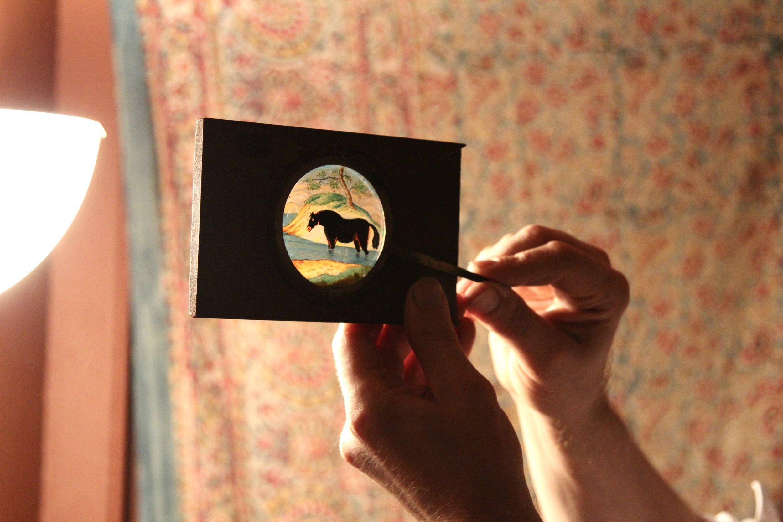 A sneak peak of a 'slip' magic lantern slide as part of a series of hand painted 'slip' slides
