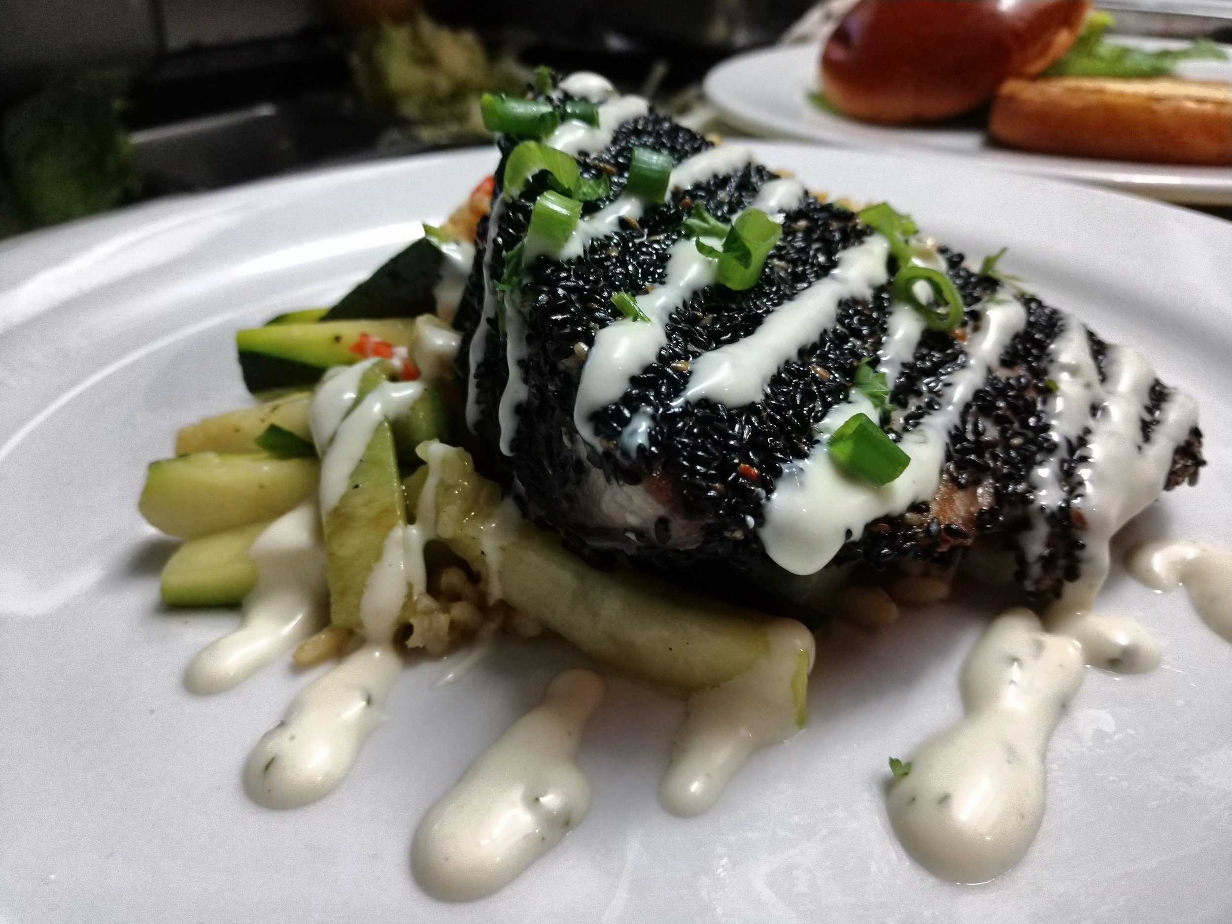 Sesame crusted fresh catch with Wasabi, served with grilled vegetables