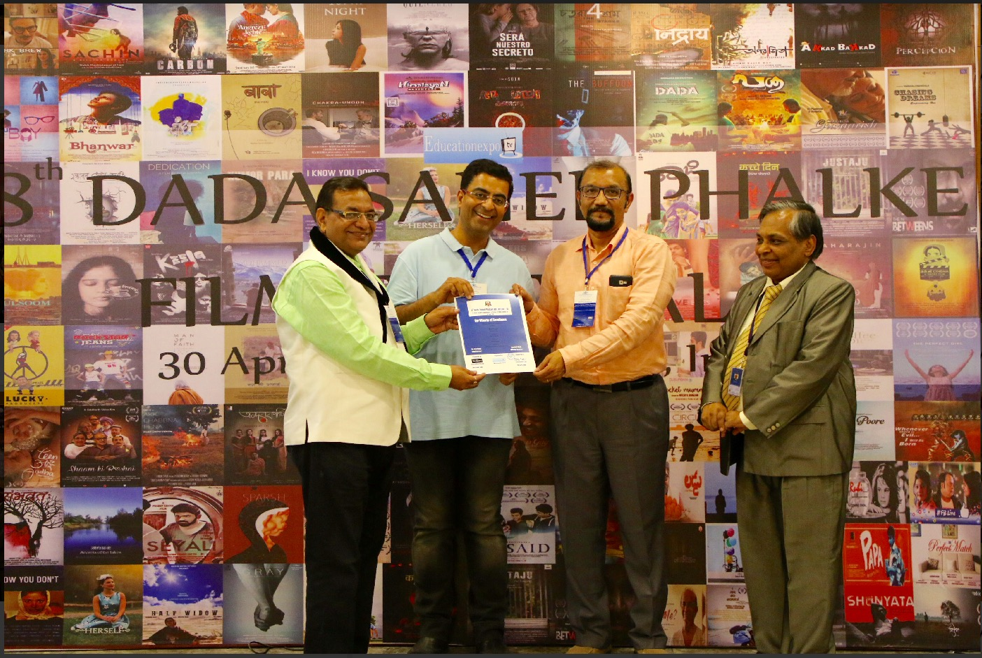 Special thanks to our COO Devendra Reddy [2nd from right] for making it to the Festival to receive the award.