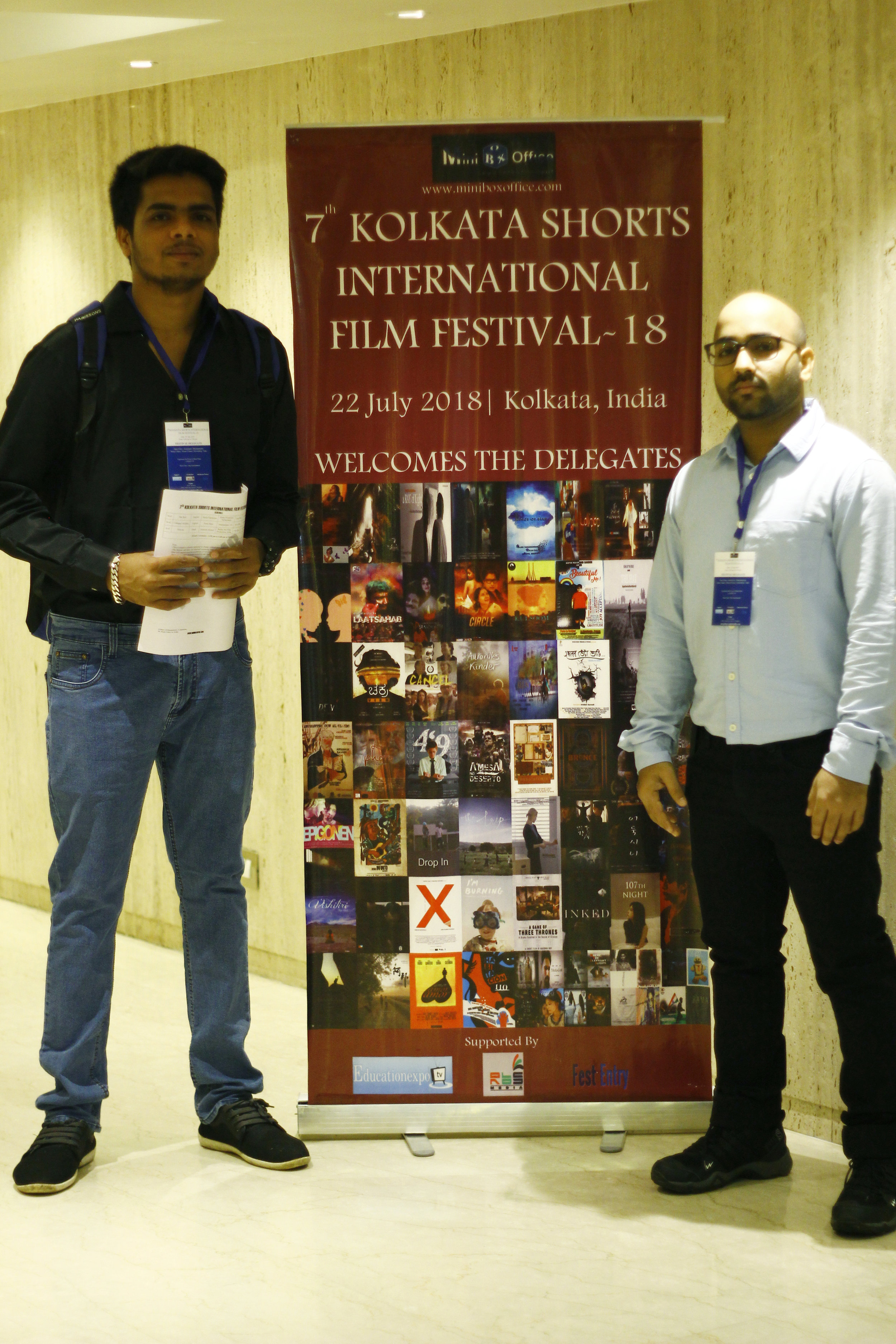 Our Media Executives Rupesh Sahu (left) & Santosh Panigrahi (right) next to the official banner at the festival.