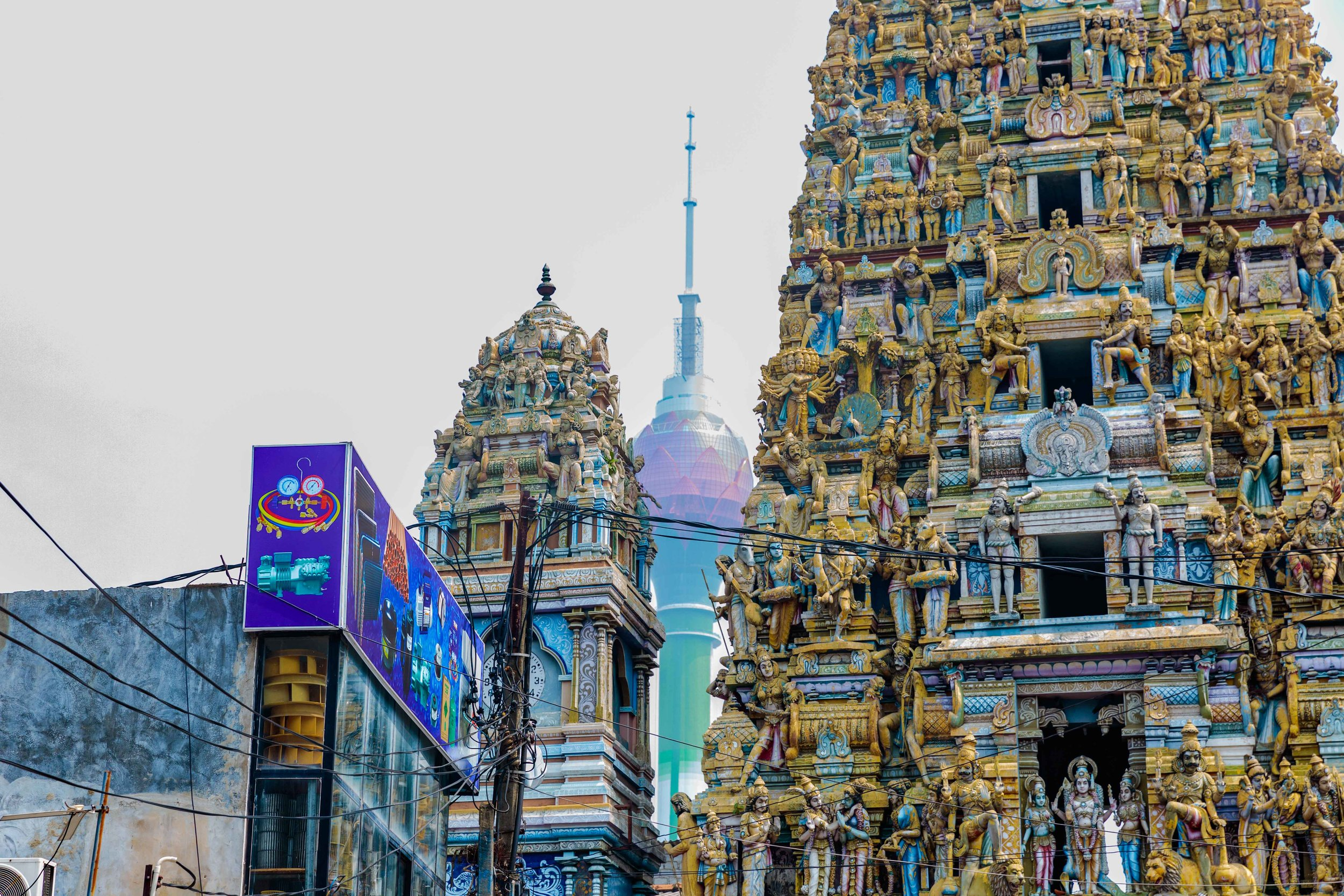 This shot optimises how Colombo amalgamates old and new with the Temple of Sri Kailawasanathan Swami Devasthanam Kovi overseen by the Lotus Tower
