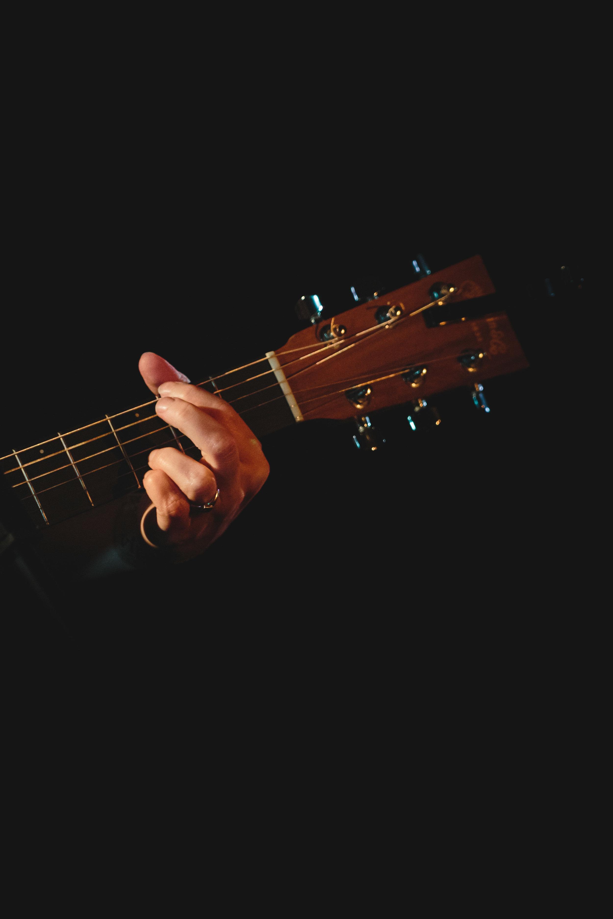 Helen Chambers Playing Guitar