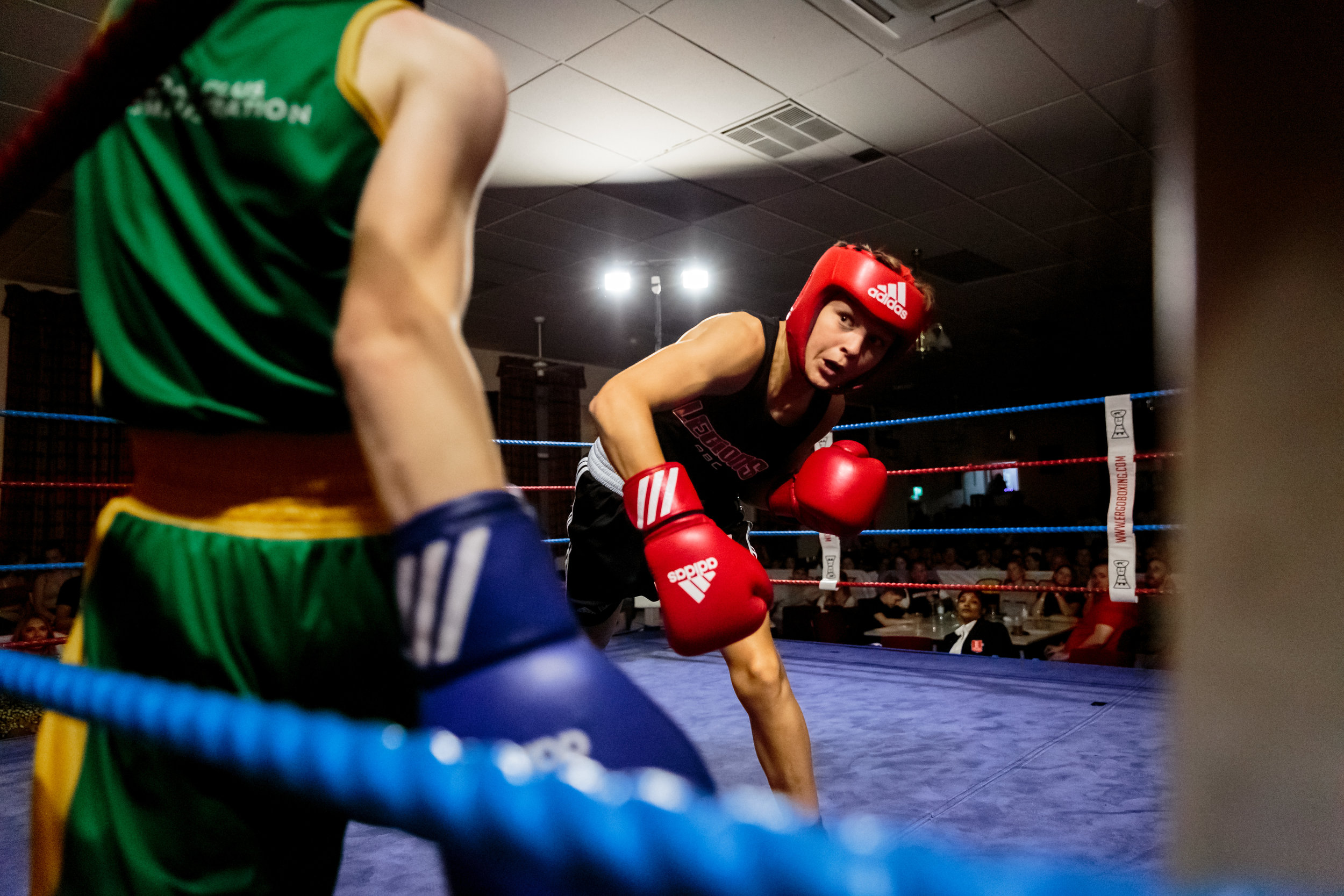 Amateur boxers against the ropes